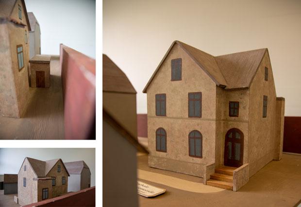 verschiedene Ansichten eines Modells eine zweistöckigen Gebäudes.